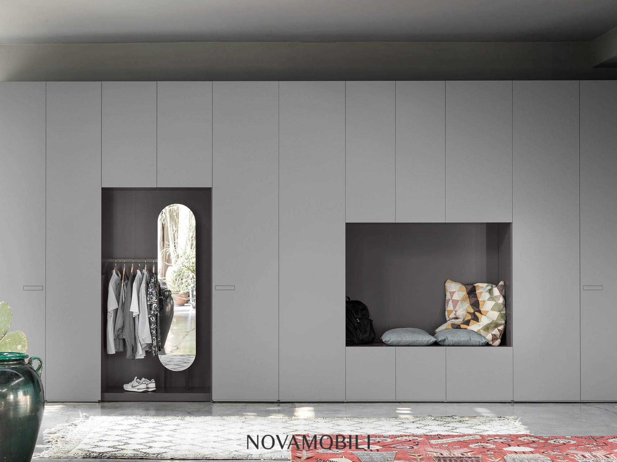 Wardrobe space in grey designer bedroom by Hubble