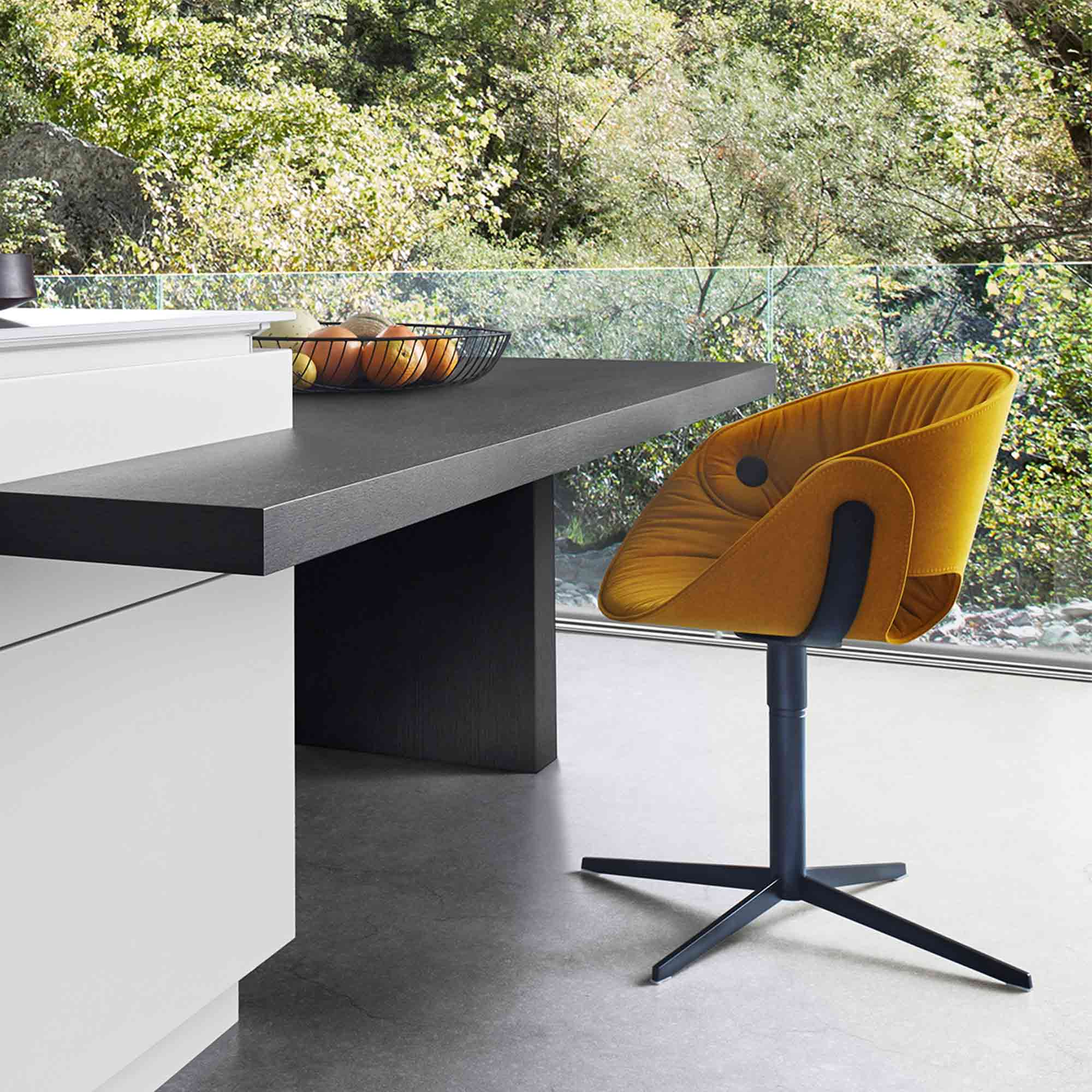 Designer dining area with orange chair by Hubble
