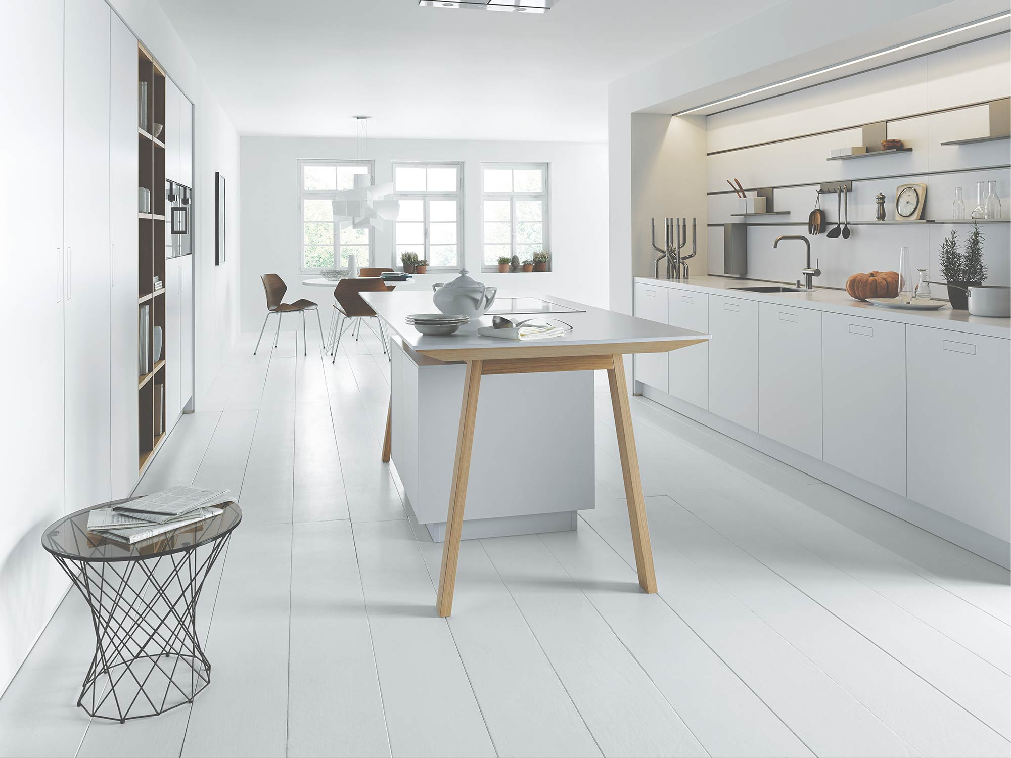 Clean white kitchen and breakfast room design by Hubble