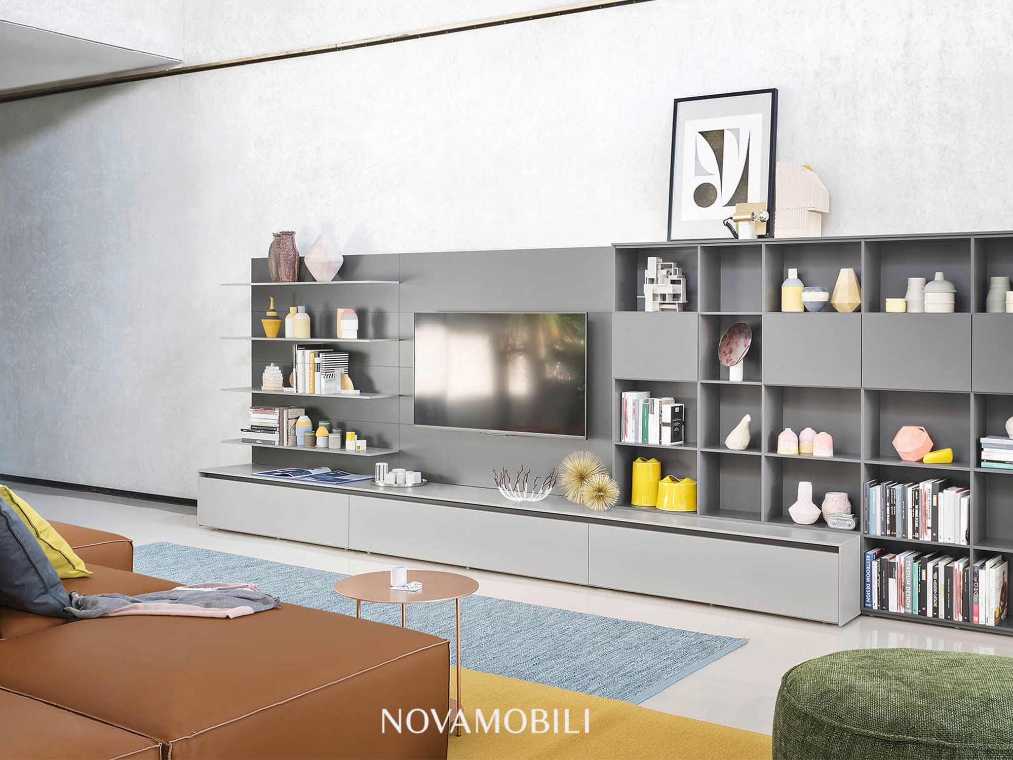Modern living room interior design by Hubble with sofa and shelving