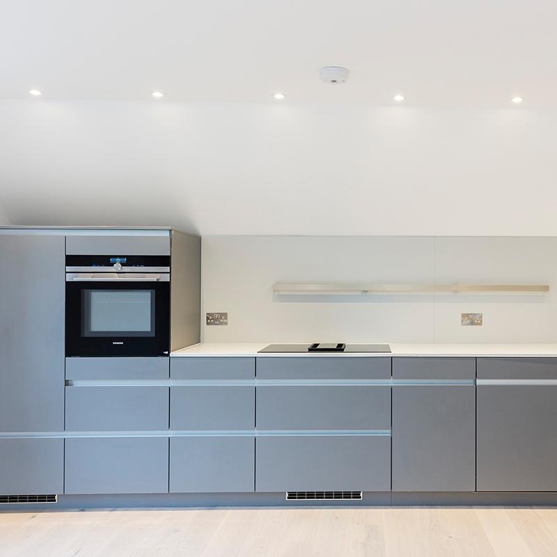 Modern grey designer kitchen fitting by Hubble