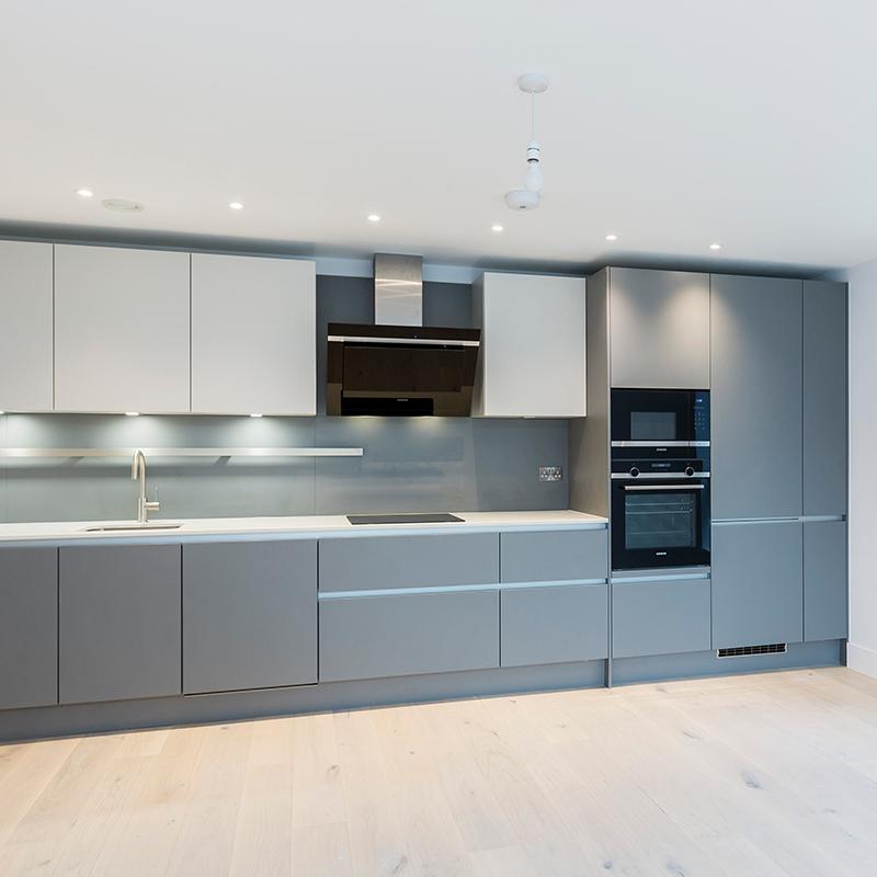 Sleek grey designer kitchen fitting by Hubble