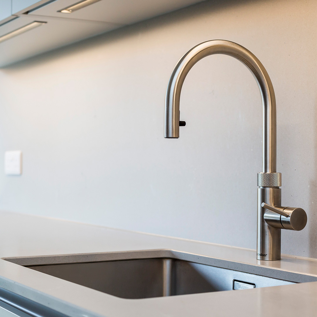 Modern sink and tap in minimal kitchen design fitting by Hubble