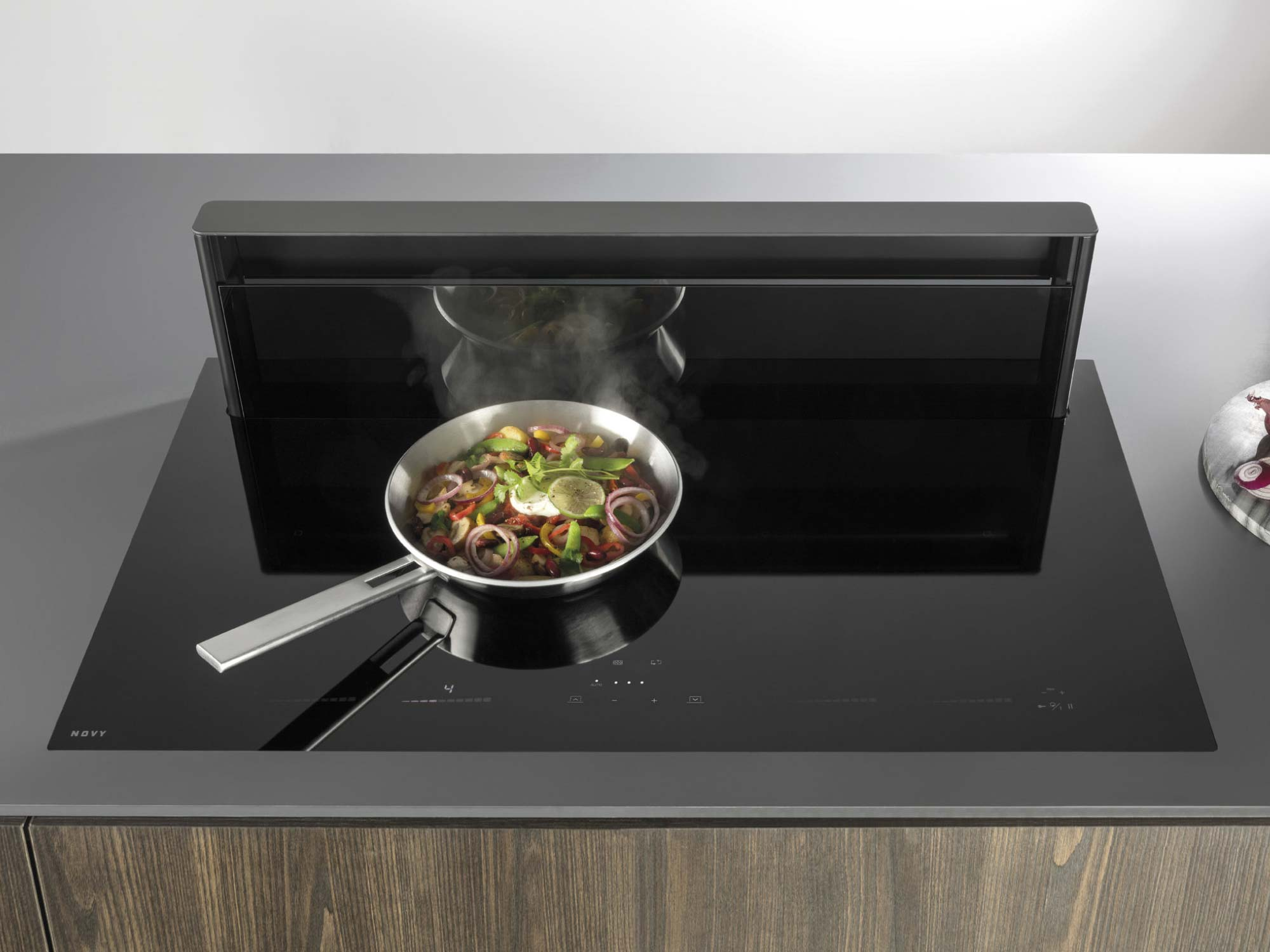 Downdraft kitchen hob example with pan - Hubble Kitchens