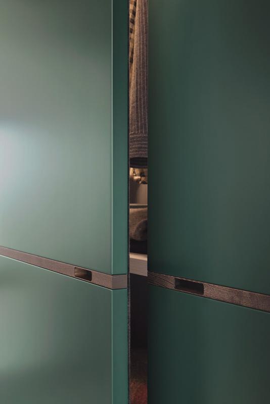 Novambili green wardrobe slight open - Hubble Kitchens