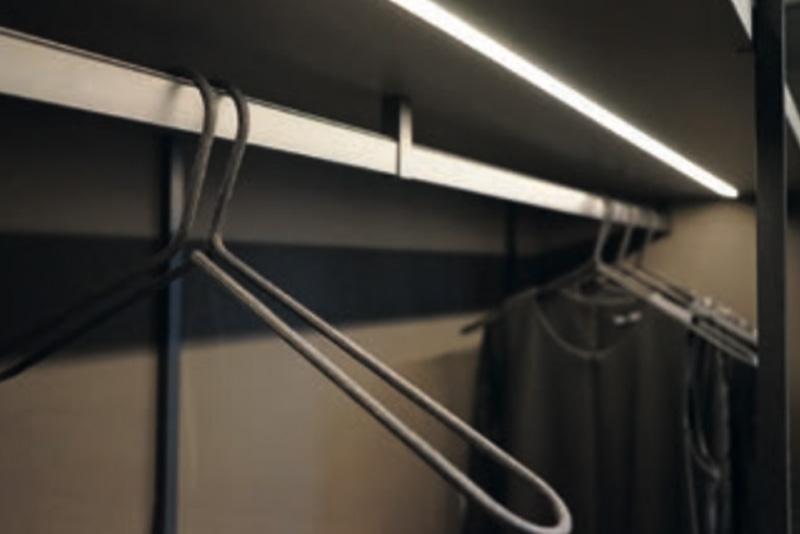Hanging rail inside lit wardrobe - Hubble Kitchens