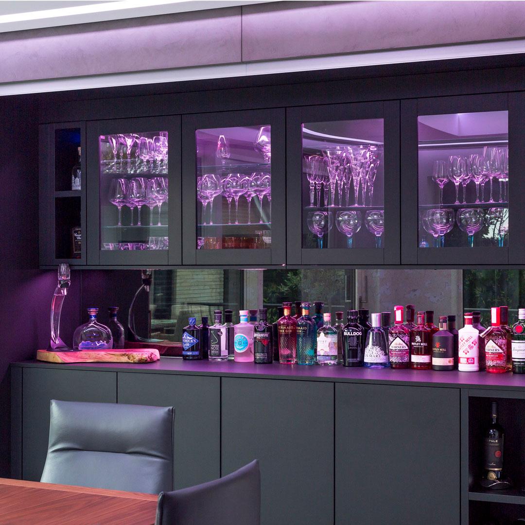 Drayton Lane purple lit glass cupboard - Hubble Kitchens